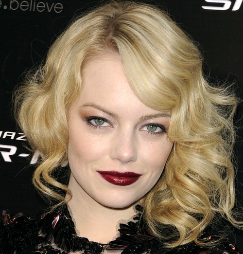 Image of Emma Stone with blonde hair, sultry eyes and a dark lipstick