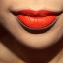How to Wear a Bold Orange Lip Color