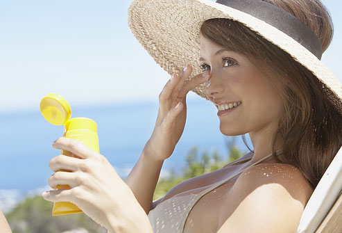 A Picture of a Woman Applying Sunscreen