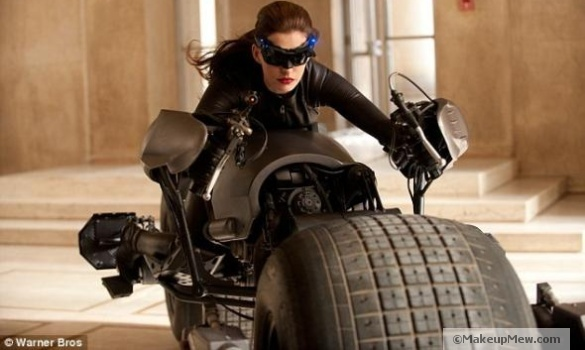 Image of Anne Hathaway on a Bat Mobile