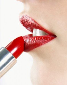 picture of woman applying lipstick